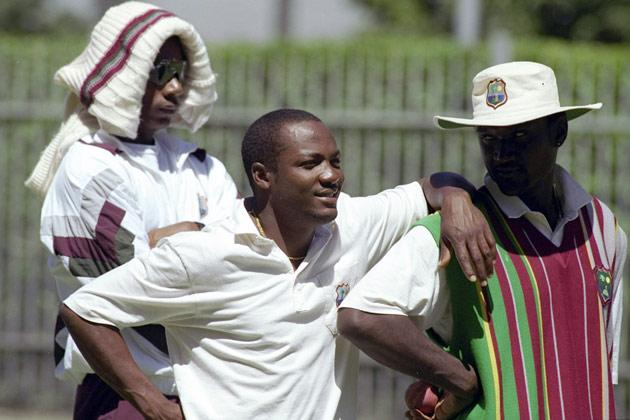 27 Dec 1996:  Brian Lara of the West Indies (left) enjoys a joke with teammate Carl Hooper during the third test between Australia and West Indies at the MCG in Melbourne, Australia. Mandatory Credit: Shaun Botterill/Allsport
