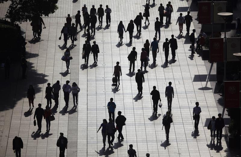 People walk along a pedestrian street in downtown Shanghai April 26, 2013. REUTERS/Carlos Barria