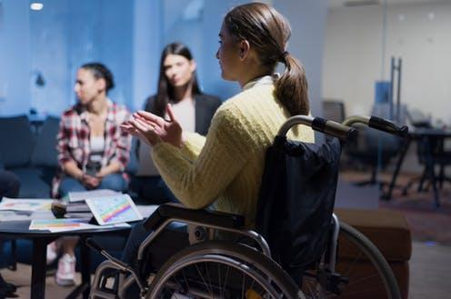 "<span class=""caption"">Only 9% of London firms reported that they collect data on their disability pay gap.</span> <span class=""attribution""><a class=""link rapid-noclick-resp"" href=""https://www.shutterstock.com/image-photo/handicapped-young-woman-colleagues-working-office-1669501207"" rel=""nofollow noopener"" target=""_blank"" data-ylk=""slk:as-artmedia/Shutterstock"">as-artmedia/Shutterstock</a></span>"