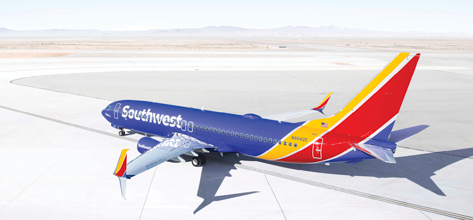 Southwest aircraft on airport tarmac in a desert climate.
