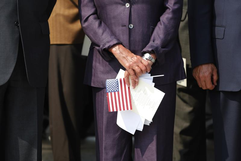 U.S. House Minority Leader Pelosi holds a U.S. flag during a remembrance of lives lost in the 9/11 attacks in Washington