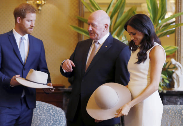 Meghan, Duchess of Sussex, also receives a traditional Australian hat.