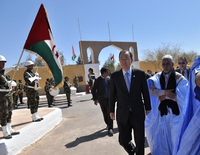 UN Secretary General Ban Ki-moon (C) arrives at the Sahrawi refugee camp of Rabouni, south of the Algerian city of Tindouf in the disputed territory of Western Sahara, March 5, 2016