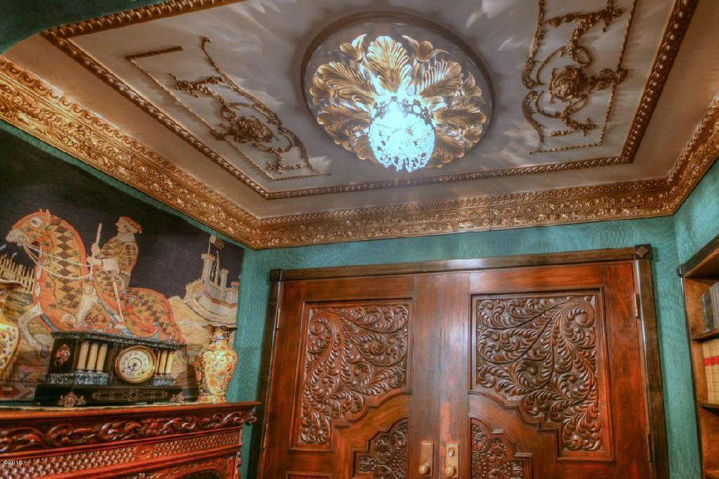 <p>The walls are covered in silk and the ceilings are finished with gilded trim.</p>