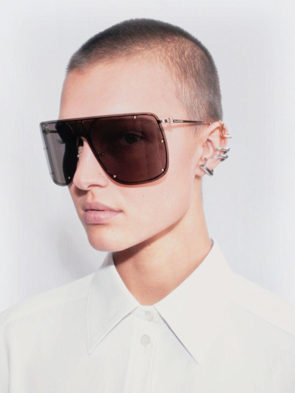 """<p><strong>Who: </strong>Alexander McQueen</p><p><strong>What: </strong>Skull Mask sunglasses</p><p><strong>Where:</strong> Available on Alexandermcqueen.com</p><p><strong>Why: </strong>We're all used to covering our faces at this point, and these McQueen sunglasses allow for even more facial coverage. The XL frames are industrial chic and will keep you covered from the sun all summer long. The metal frames have a miniature skull on the temple, a signature motif of McQueen that brings the gothic edge to these sleek sunnies.</p><p><a class=""""link rapid-noclick-resp"""" href=""""https://go.redirectingat.com?id=74968X1596630&url=https%3A%2F%2Fwww.alexandermcqueen.com%2Fen-us%2Fsearch%3Fq%3Dskull%2Bmask%26lang%3Den_US&sref=https%3A%2F%2Fwww.elle.com%2Ffashion%2Fshopping%2Fg35685914%2Fmarch-2021-fashion-collaborations-launches%2F"""" rel=""""nofollow noopener"""" target=""""_blank"""" data-ylk=""""slk:SHOP NOW"""">SHOP NOW</a></p>"""