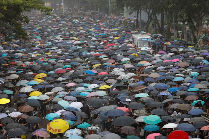 Thousands of people streamed into a park in central Hong Kong for what organizers hoped would be a peaceful demonstration for democracy in the semi-autonomous Chinese territory.