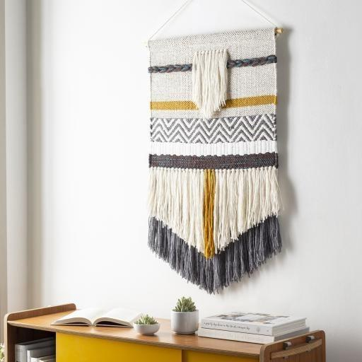 """<p>""""I'm all about giving my home a cozy refresh in the fall, and this beautiful handwoven <span>Jungalow Gold Chevron Wall Hanging</span> ($99) would add some warmth to my walls when the temps start dropping."""" - TB</p>"""