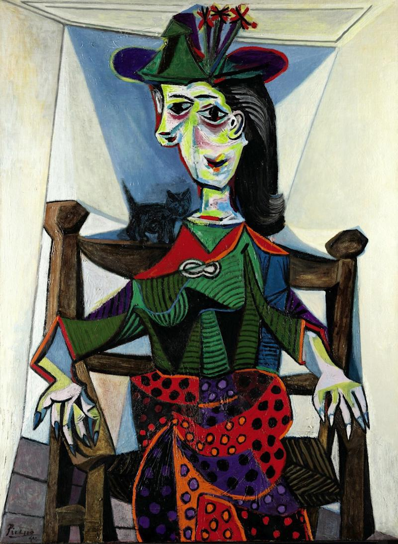 """FILE - This undated photo provided by Sotheby's shows """"Dora Maar au Chat,"""" by Pablo Picasso. The 1941 painting, which sold in May 2006 for $95,216,000  is one of eight works that have sold for $80 million or more at auction. When Edvard Munch's """"The Scream,"""" is auctioned at Sotheby's in New York Wednesday May 2, 2012, it could sell for $80 million or more. (AP Photo/ Sotheby's, File)"""