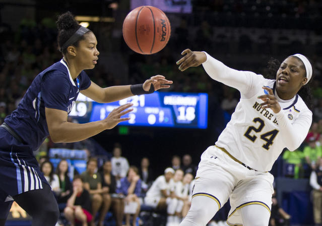 Notre Dame's Arike Ogunbowale, right, passes around Villanova's Jannah Tucker, left, during a second-round game in the NCAA women's college basketball tournament Sunday, March 18, 2018, in South Bend, Ind. (AP Photo/Robert Franklin)