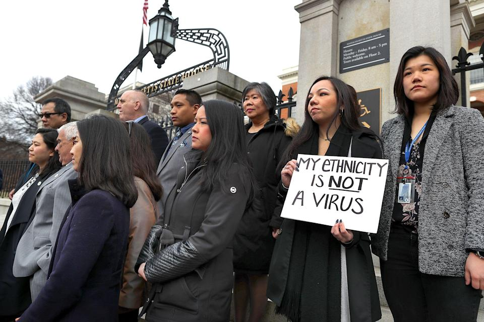 Members of the Asian American Commission hold a press conference on the steps of the Massachusetts State House to condemn racism toward the Asian American community because of coronavirus on March 12 in Boston. (John Tlumacki/The Boston Globe via Getty Images)
