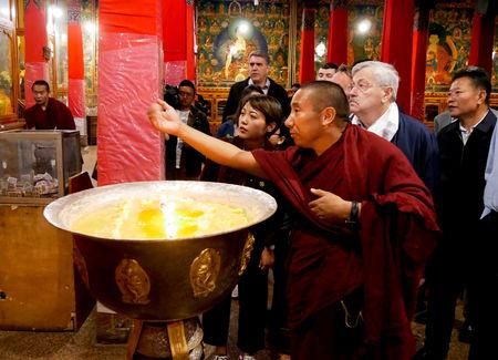 FILE PHOTO: U.S. Ambassador to China Terry Branstad visits Tibet Autonomous Region, China, in this May 22, 2019 handout picture provided by the U.S. Mission to China. U.S. Mission to China/Handout via REUTERS