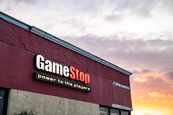 ATHENS, OHIO, UNITED STATES - 2021/02/02: GameStop logo is seen at one of their stores in Athens. Businesses that line East State Street in Athens, Ohio, an Appalachian community in southeastern Ohio. Small investors force invested heavily in Gamestop, creating the first ever short squeeze by reddit users in the online group WallStreetBets. The massive investments in Gamestop by everyday people have challenged many stock trading norms, and have upset the balance of power on Wall Street, generally dominated by hedge fund groups. (Photo by Stephen Zenner/SOPA Images/LightRocket via Getty Images)