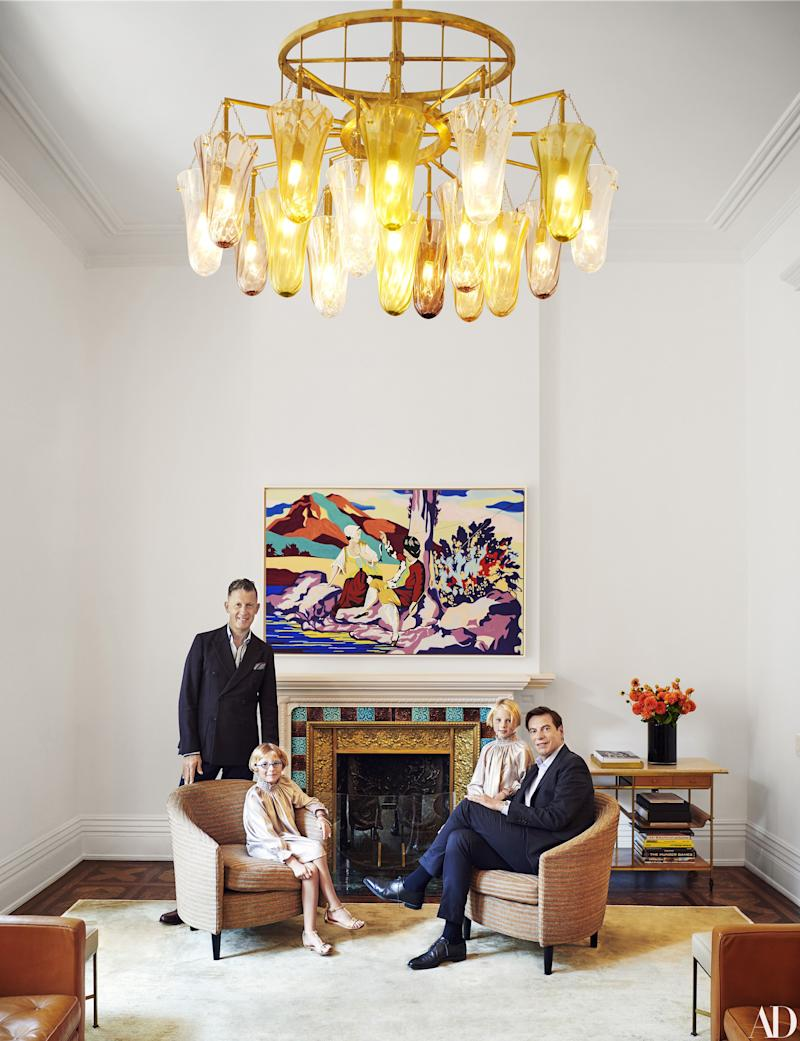 Stefano Tonchi (left) and David Maupin with daughters Isabella and Maura in the living room. Painting by David Salle; Vica armchairs in a handwoven cork blend by Sylvie Johnson Paris.