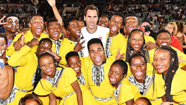 Roger Federer hugs the kids after the Match in Africa between Roger Federer and Rafael Nadal at Cape Town Stadium in February, 2020. (Photo by Ashley Vlotman/Gallo Images/Getty Images)
