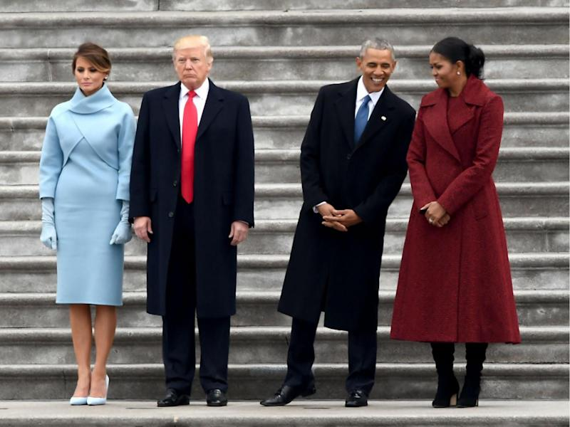 The Obamas and Trumps stand on the East front steps of the US Capitol after inauguration ceremonies on January 20, 2017 in Washington, DC (ROBYN BECK/AFP/Getty Images)