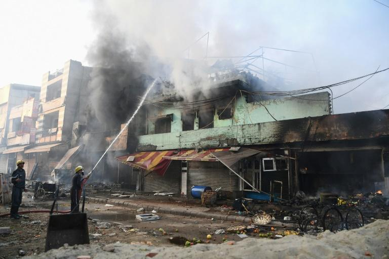 Buildings were torched in clashes between supporters and opponents of a controversial new Indian citizenship law