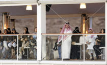 """In this Saturday, Dec. 14, 2019 photo, Equestrian fans watch the Diriyah Equestrian Festival, where male and female equestrians are riding side-by-side for the first time in Riyadh Saudi Arabia. Prince Abdulaziz bin Turki al-Faisal, who leads the General Sports Authority, said during an interview with the Associated Press that """"Sports has been a tool for social change within the kingdom,"""" , adding a lot of that effort has been geared toward encouraging and open the realm of sports to Saudi women. (AP Photo/Amr Nabil)"""
