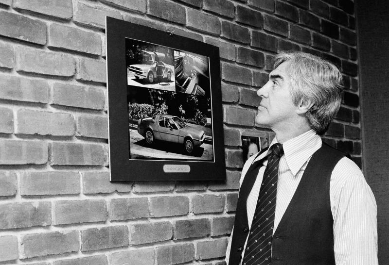 Quit General Motors to start his own firm John Z. DeLorean who stunned the auto industry five years ago by quitting a top post at general motors, looks over photos of the sports car the DeLorean motor co. plans to produce in northern Ireland. Starting your own car company is not an original idea, but few have succeeded. DeLorean thinks his effort will be a success, Dec. 6, 1978. (AP Photo/Pickoff)