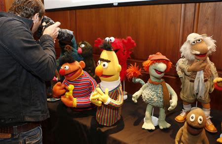 News photographer shoots puppets from Sesame Street and Muppets fame after they were donated to the Smithsonian's National Museum of American History in Washington