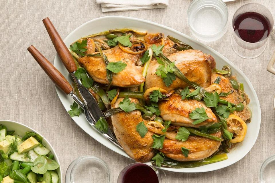 """No ramps? Use scallions instead to make this simple, lemony roast chicken. <a href=""""https://www.epicurious.com/recipes/food/views/roasted-chicken-with-lemon-ramps-and-green-olives-56389340?mbid=synd_yahoo_rss"""" rel=""""nofollow noopener"""" target=""""_blank"""" data-ylk=""""slk:See recipe."""" class=""""link rapid-noclick-resp"""">See recipe.</a>"""