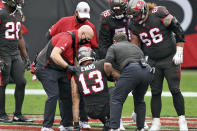 Tampa Bay Buccaneers wide receiver Mike Evans (13) is helped to his feet after getting injured against the Atlanta Falcons during the first half of an NFL football game Sunday, Jan. 3, 2021, in Tampa, Fla. Evans left the game. (AP Photo/Jason Behnken)
