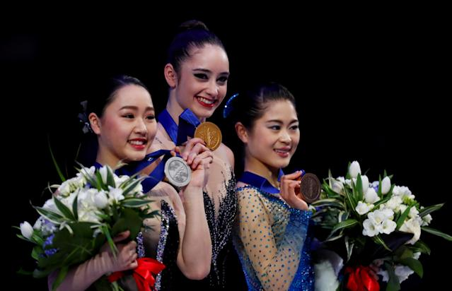 FILE PHOTO: Figure Skating - World Figure Skating Championships - The Mediolanum Forum, Milan, Italy - March 23, 2018 Canada's Kaetlyn Osmond poses with the gold medal as Japan's Wakaba Higuchi and Satoko Miyahara pose with their respective silver and bronze medals after the Ladies Free Skating REUTERS/Alessandro Garofalo/File Photo