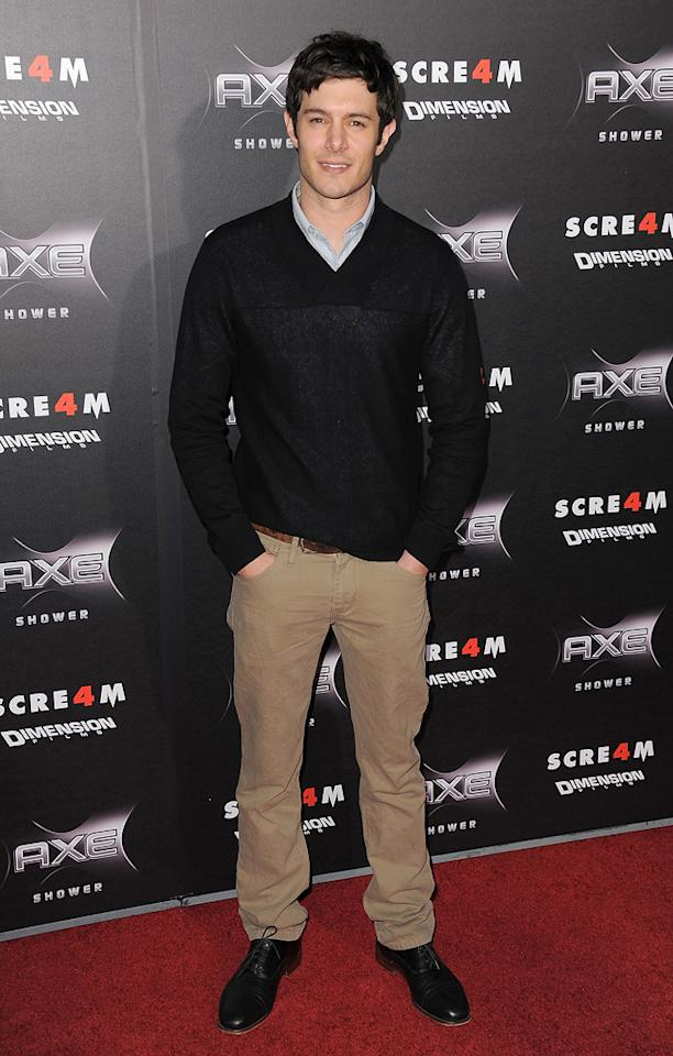 """Anthony's <a href=""""http://movies.yahoo.com/movie/1810035905/info"""">Scream 4</a> sidekick, <a href=""""http://movies.yahoo.com/movie/contributor/1804572880"""">Adam Brody</a>, appeared a tad casual in a black sweater and brown cords."""