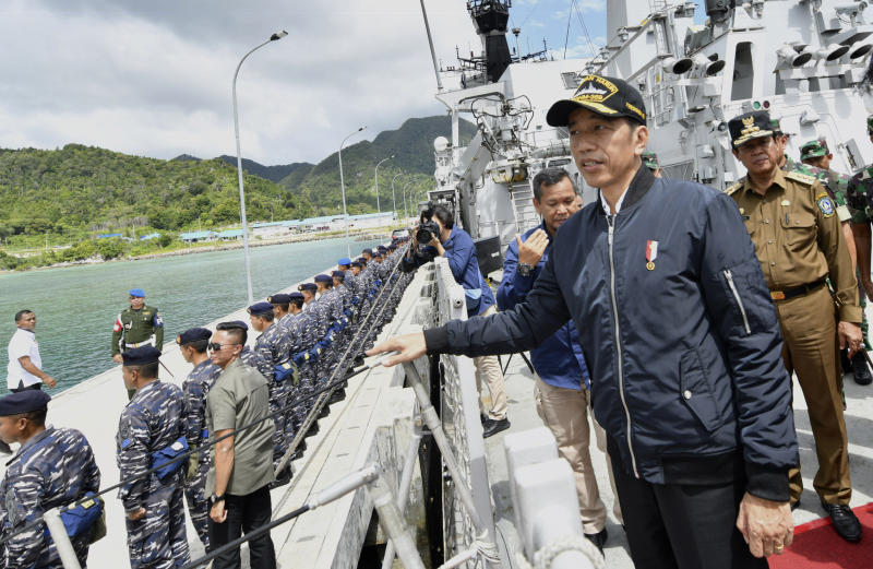 In this photo released Indonesian Presidential Office, Indonesian President Joko Widodo, second right, stands on the deck of Indonesian Navy ship KRI Usman Harun at Selat Lampa Port, Natuna Islands, Indonesia, Wednesday, Jan. 8, 2020. Indonesian President Joko Widodo on Wednesday visited the Natuna islands that overlap with China's expansive claim to the South China Sea amid heightened tensions over the waters after Beijing recently claimed it was their traditional fishing area. (Agus Soeparto, Indonesian Presidential Office via AP)