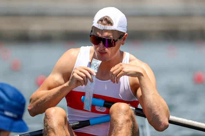 <p>Trevor Jones of Team Canada consumes an ice treat prior to the Men's Single Sculls Quarterfinal 2 on day two of the Tokyo 2020 Olympic Games at Sea Forest Waterway on July 25, 2021 in Tokyo, Japan. (Photo by Buda Mendes/Getty Images)</p>