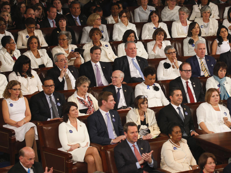 Democratic women in white listen to US President Donald Trump: REUTERS