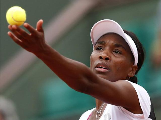 US Venus Williams serves to Poland's Agnieszka Radwanska during their Women's Singles 2nd Round tennis match of the French Open tennis tournament at the Roland Garros stadium, on May 30, 2012 in Paris. AFP PHOTO / KENZO TRIBOUILLARDKENZO TRIBOUILLARD/AFP/GettyImages