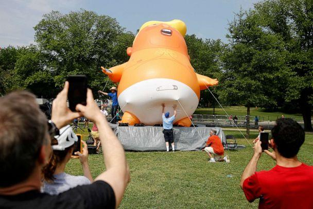 PHOTO: People photograph a Baby Trump balloon as it is moved into position before Independence Day celebrations, July 4, 2019, on the National Mall in Washington. (Patrick Semansky/AP)