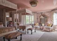 """<p>True to form, ELLE DECOR A-List designer <a href=""""https://martynlawrencebullard.com/"""" rel=""""nofollow noopener"""" target=""""_blank"""" data-ylk=""""slk:Martyn Lawrence Bullard"""" class=""""link rapid-noclick-resp"""">Martyn Lawrence Bullard</a> looked to his travels in designing the romantic """"Jaipur Room."""" With French sepia palm garden wallpaper, faux ivory canopy beds, and Bullard's own diaphanous embroidered linen curtains from the Shade Store hanging from the canopy beds and windows, guests are sure to be transported as well. <br></p>"""