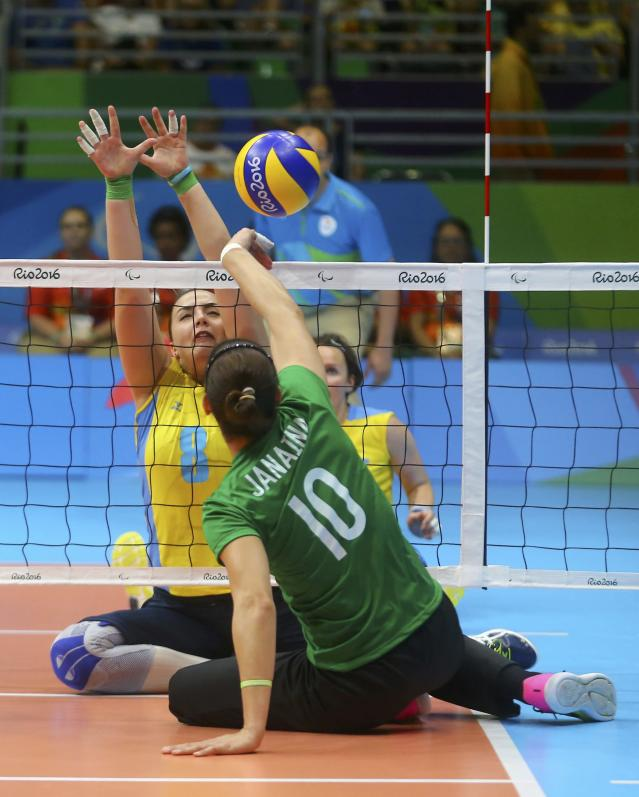 2016 Rio Paralympics - Sitting Volleyball - Women's Bronze Match - Riocentro Pavilion 6 - Rio de Janeiro, Brazil, 17/09/2016. Oleksandra Podliesna (UKR) of Ukraine and Janaina Petit Cunha (BRA) of Brazil in action. REUTERS/Pilar Olivares FOR EDITORIAL USE ONLY. NOT FOR SALE FOR MARKETING OR ADVERTISING CAMPAIGNS.