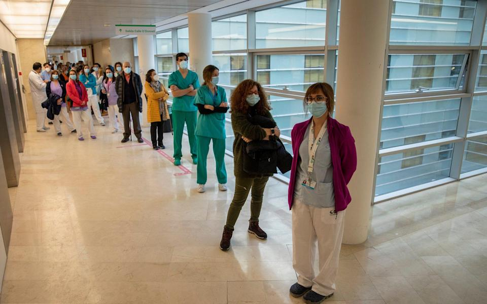 Health care workers queue before receiving a dose of the Pfizer-BioNTech Covid-19 vaccine at Gregorio Maranon Hospital during the third wave of the Coronavirus pandemic - Pablo Blazquez Dominguez/Getty Images Europe