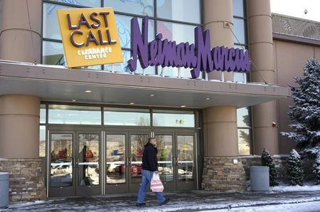 File Photo: A customer walks by the Neiman Marcus Last Call store in Golden