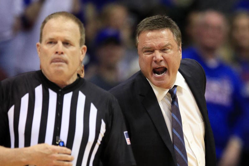 Kansas head coach Bill Self, right, yells at referee Gerry Pollard, left, during the second half of an NCAA college basketball game against Oklahoma in Lawrence, Kan., Saturday, Feb. 15, 2020. Kansas defeated Oklahoma 87-70. (AP Photo/Orlin Wagner)