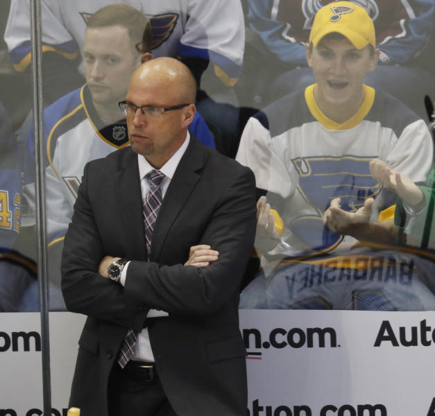 FILE - In this March 31, 2017, file photo, St. Louis Blues head coach Mike Yeo looks on in the first period of an NHL hockey game against the Colorado Avalanche, in Denver. Here comes Minnesota's first-round opponent, none other than the surging St. Louis team coached by former Wild bench boss Mike Yeo. (AP Photo/David Zalubowski, File)