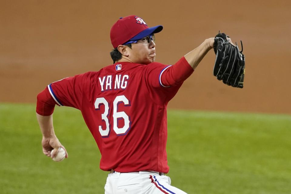 Texas Rangers relief pitcher Hyeon-Jong Yang throws to a Boston Red Sox batter during the third inning of a baseball game in Arlington, Texas, Friday, April 30, 2021. (AP Photo/Tony Gutierrez)