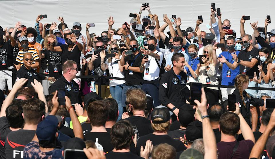The crew of Inspiration4 (from left) Sian Proctor, Chris Sembroski, Jared Isaacman and Hayley Arceneaux wave as they head to the launch pad Wednesday afternoon.