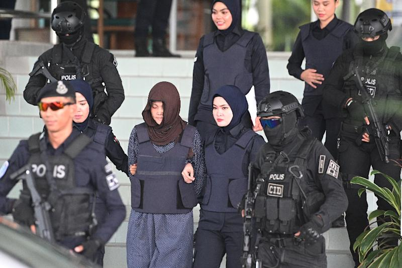 Malaysian prosecutors say Doan Thi Huong (2nd L) will remain on trial for the gruesome murder of Kim Jong Nam with a toxic nerve agent at a Kuala Lumpur airport in 2017