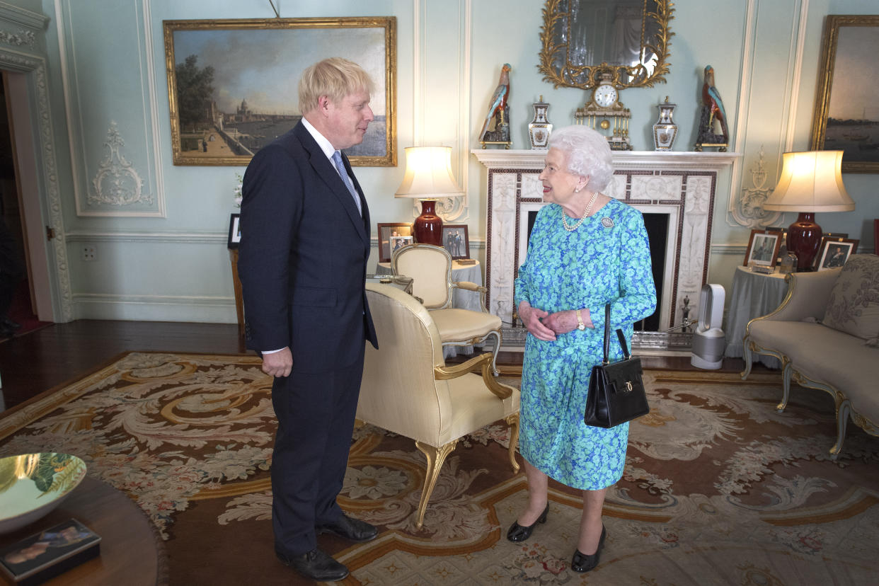 Queen Elizabeth II welcomes newly elected leader of the Conservative party Boris Johnson during an audience in Buckingham Palace, London, where she invited him to become Prime Minister and form a new government.