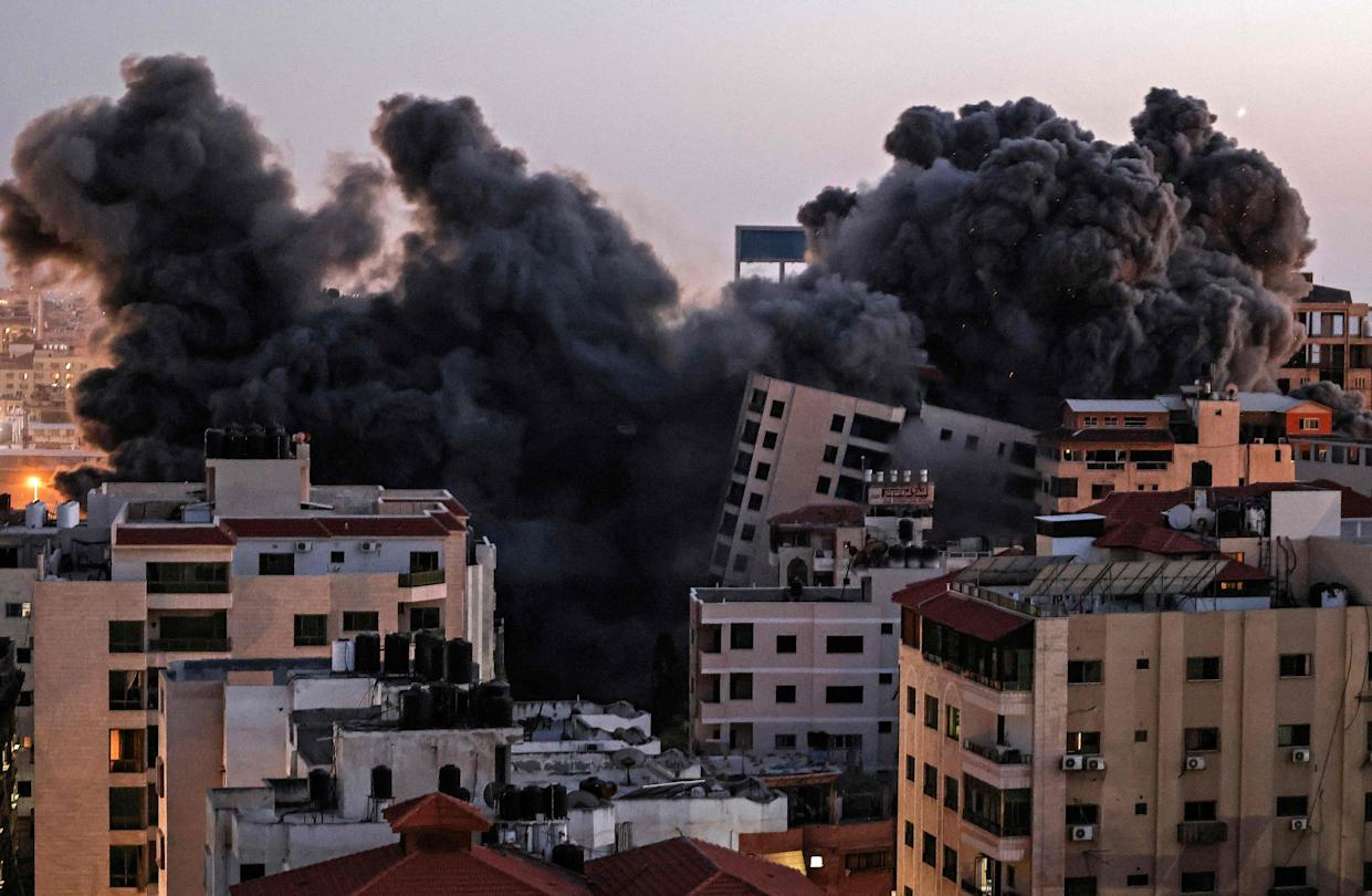 TOPSHOT - Smoke billows from an Israeli air strike on the Hanadi compound in Gaza City, controlled by the Palestinian Hamas movement, on May 11, 2021. (Photo by MAHMUD HAMS / AFP) (Photo by MAHMUD HAMS/AFP via Getty Images)