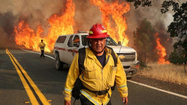 PHOTO: Chula Vista firefighter Rudy Diaz monitors the LNU Lightning Complex Fire as it engulfs brush in Lake County, Calif., Aug. 23, 2020. (Adrees Latif/Reuters)