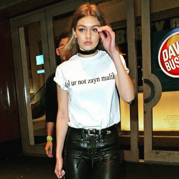 <p>Leaving Drake's <i>Saturday Night Live</i>after-party at Dave and Buster's, Hadid was spotted wearing her love for Zayn on her sleeve (or shirt?) — literally. Now that's one way to repel her, presumably many, unwanted suitors… (Photo: Instagram)</p>