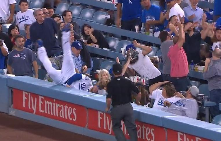 Los Angeles Dodgers All-Star Max Muncy nearly wiped out a fan while pursuing a foul ball. (MLB.TV)