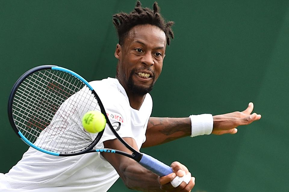 France's Gael Monfils returns against France's Ugo Humbert during their men's singles first round match on the first day of the 2019 Wimbledon Championships at The All England Lawn Tennis Club in Wimbledon, southwest London, on July 1, 2019. (Photo by Glyn Kirk/AFP/Getty Images)