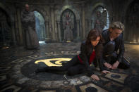 """This film publicity image released by Screen Gems shows Jamie Campbell Bower as Jace, right, and Lilly Collins as Clary in a scene from """"The Mortal Instruments: City of Bones. (AP Photo/Sony Pictures Screen Gems, Rafy)"""