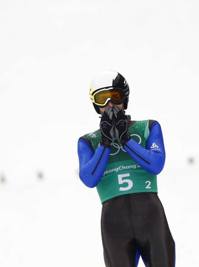 Nordic Combined Events - Pyeongchang 2018 Winter Olympics - Men's Team Gundersen LH Competition - Alpensia Ski Jumping Centre - Pyeongchang, South Korea - February 22, 2018 - Jason Lamy Chappuis of France reacts. REUTERS/Kai Pfaffenbach
