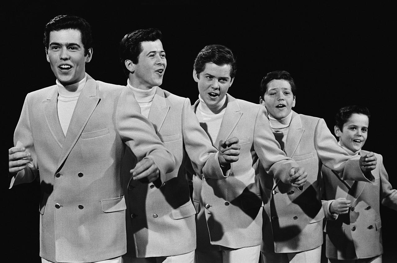 """<p>The Osmonds almost always matched exactly, though eventually they took a cue from <a rel=""""nofollow"""" href=""""http://www.phoenixnewtimes.com/music/the-osmonds-talking-karate-chuck-norris-glam-metal-and-elvis-with-merrill-osmond-6601466?mbid=synd_yahoostyle""""><b>Elvis</b> himself</a> and wore studded jumpsuits (still all matching).</p>"""